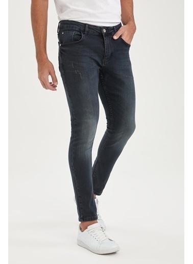 DeFacto Skinny Comfort Fit Normal Bel Dar Paça Yırtık Detaylı Jean Pantolon Hardal